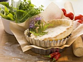 Ingredients for tarts: pastry cases and herbs