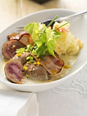Veal kidneys on orange and mustard sauce