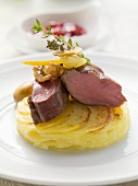 Roast loin of venison (medium) with pear and potato gratin