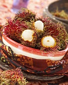 Several rambutans (Nephelium lappaceum) in ceramic bowl