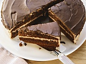 Chocolate cream cake, partly sliced