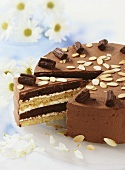 Chocolate cream cake with flaked almonds