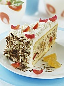 Piece of ice chip cake with candied pineapple and cherries