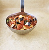 Tomato sauce with aubergine and mozzarella on ladle