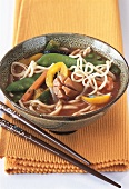 Noodle stew with vegetables and sausages (Asia)