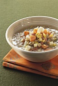 Barley soup with vegetables and bacon