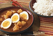 Potato curry with eggs and rice (India)