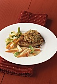 Pork steak with horseradish crust and soup vegetables