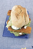 Fish fingers in baguette with cucumber and lettuce