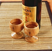 Sake in bottle and wooden cups
