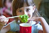 Little girl drinking herbal tea