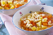 Potato and carrot soup with spaetzle noodles