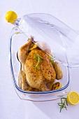 Roast chicken in glass dish