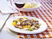 Peppered beef fillet on Italian vegetables