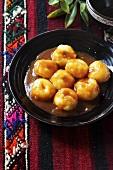 Pyzy (filled potato dumplings, Poland) with sauce