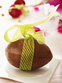 Nut chocolate Easter egg with bow