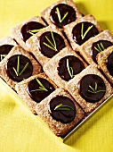 Biscuits with chocolate filling and rosemary