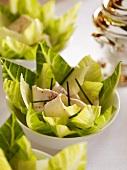 Caesar salad in porcelain bowls