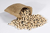 Black-eyed peas spilling out of hessian sack