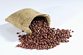 Azuki beans spilling out of hessian sack