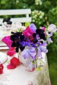 Romantic vase of flowers on garden table