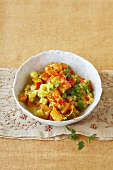 Yellow and red vegetable curry with carrots