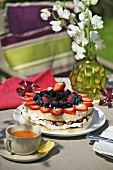 Summer berry torte, cup of tea