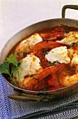 Fish, king prawn and tomato casserole