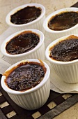 Caramelised chocolate cream in several small pots