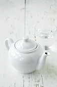 A teapot and a glass of water