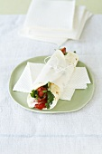 Red pepper wraps with rosemary feta cream