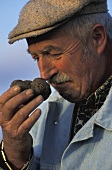 A man sniffing a fresh truffle (France)