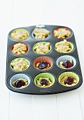 Making Linzer cupcakes (cupcake mixture in a muffin tin)