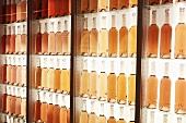 Bottles of rosé wine on shelves