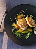 Stuffed veal fillet in coconut coating with orange and pepper chutney