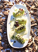Pointed cabbage leaves stuffed with spiced rice, curry horseradish sauce