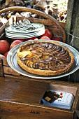 An apple tart in an autumnal garden