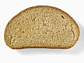 A slice of brown bread (made with wheat and rye flour)