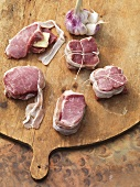 Barded entrecote steaks and pork loin steaks