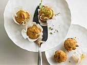 Cheese muffins on plates
