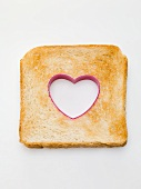 Slice of toast with a heart cut out