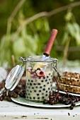 Elderberry butter in preserving jar