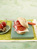 Ham, cheese and tomato in bread roll