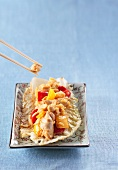 Chicken with rice and peppers on Chinese cabbage (China)