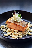 Fried salmon fillet with white beans