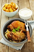 Knuckle of pork with roast potatoes and horseradish sauce