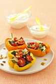 Peppers stuffed with spinach, tomatoes and pine nuts, yoghurt sauce