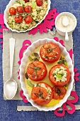 Tomatoes stuffed with rice, peas and courgettes