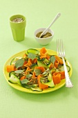 Courgette and carrot salad with pesto and sunflower seeds