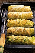 Stuffed cabbage leaves on baking tray
